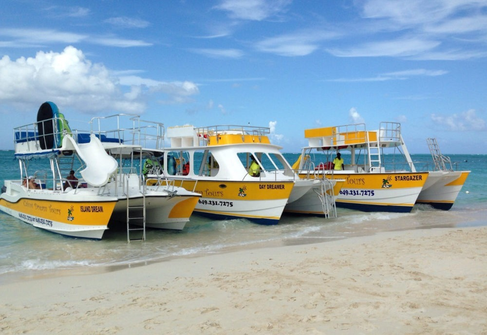 double deck boats parked on beach in Turks and Caicos