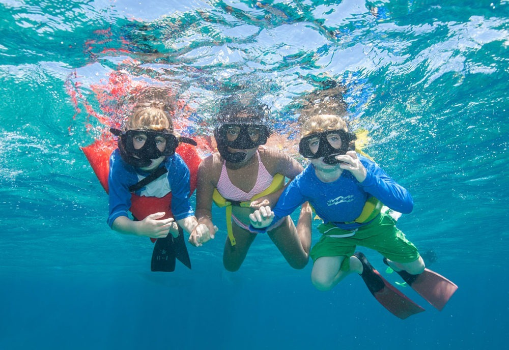 children snorkeling underwater in turks and caicos