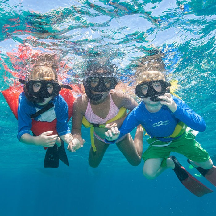 kids snorkeling underwater in turks and caicos