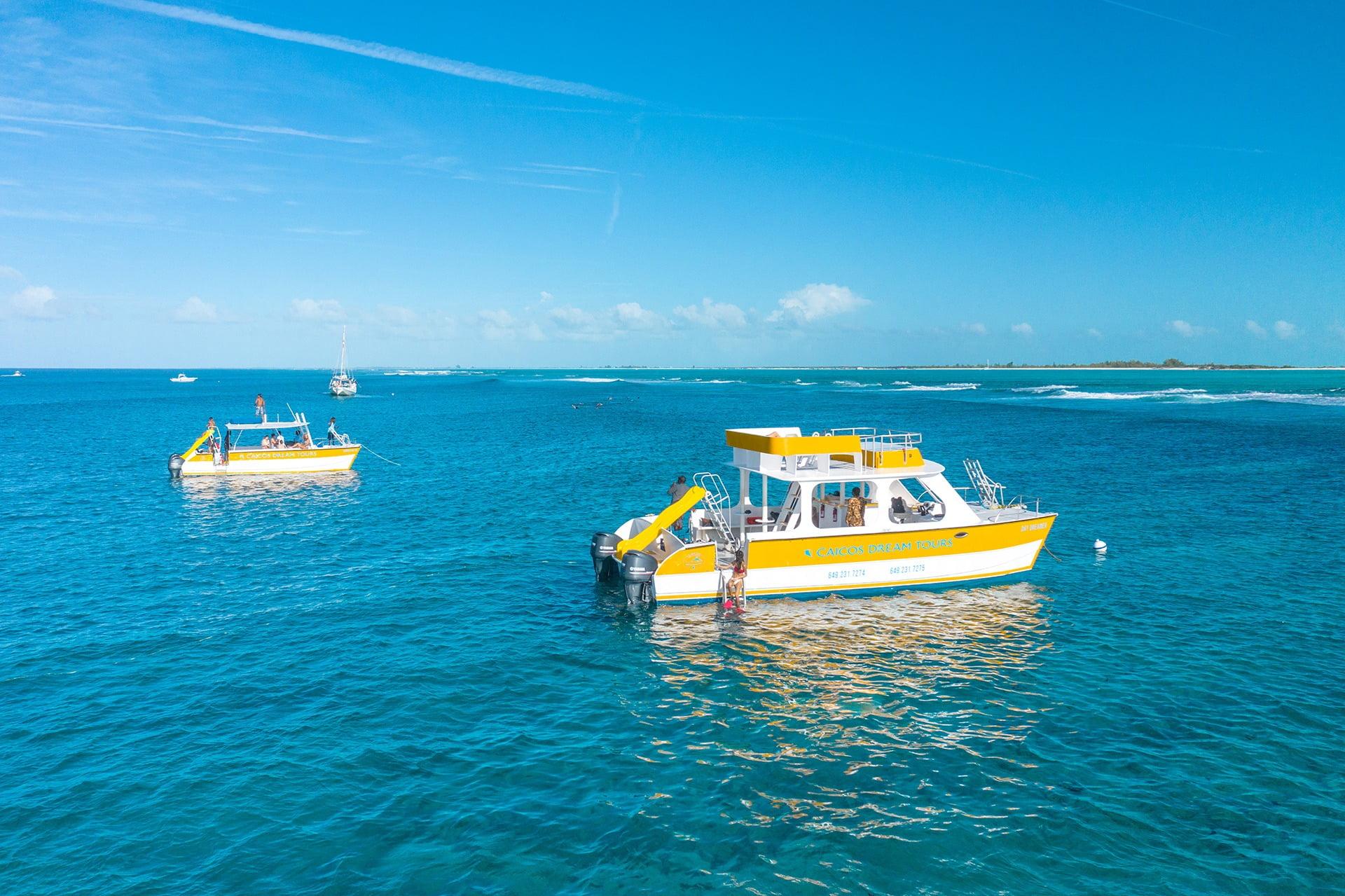 a private charter boat anchors near a sandbar