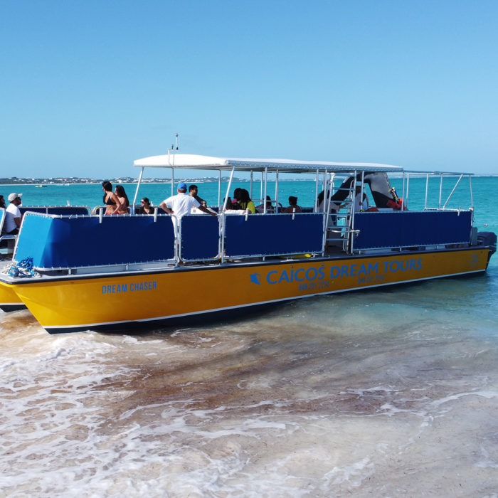 charter boat departs from the beach in providenciales