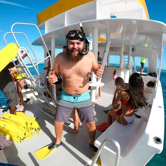 passenger prepares to snorkel in Providenciales