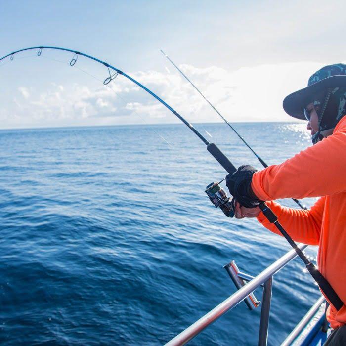 Man reeling in something huge on caicos fishing trip